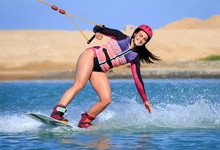 Wake Boarding Female Sportsman...