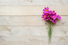 Top View Of Bouquet Of Cosmos Flower On Wooden Table With Copy Space