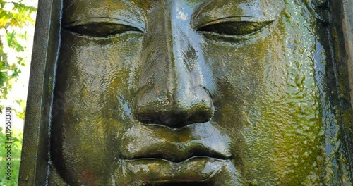 Photo  Tranquil and peaceful Buddha face expression of ancient Buddhist statue in tradi