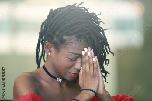 Fotografie, Obraz  Black female praying with closed eyes