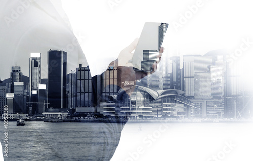 Double exposure of businessman and Hong Kong city view Poster