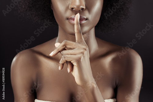 Photo  cropped shot of african american woman showing silence gesture isolated on black