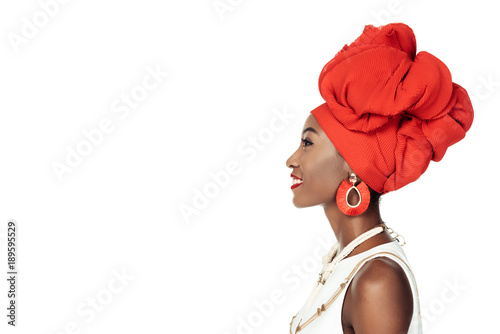 Vászonkép side view of african american woman in ethnic accessories  isolated on white