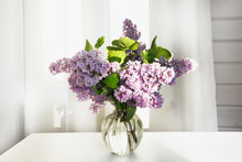 A Bouquet Of Fresh Lilacs In A...