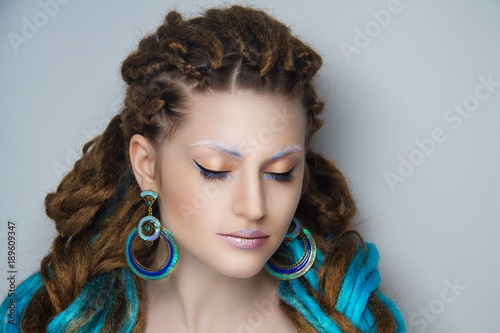 Fotografie, Obraz  Girl with blue dreadlocks