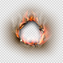 Hole Torn In Ripped Paper With Burnt And Flame