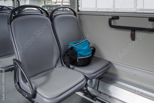 Fotomural  a bag on the seat in bus