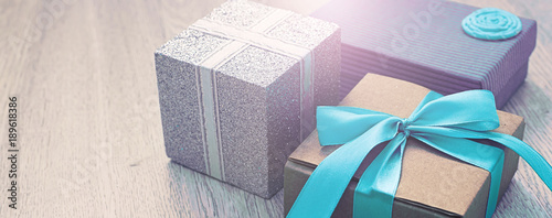Banner Decorative gift boxes on wooden background. Wallpaper Mural