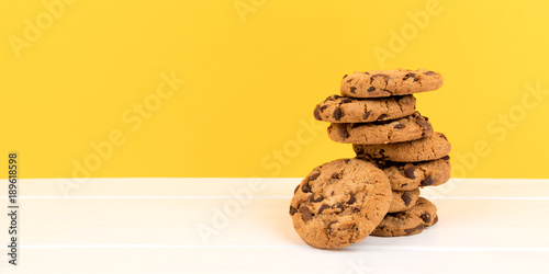 Fototapeta cookies with yellow background and copy space panorama obraz