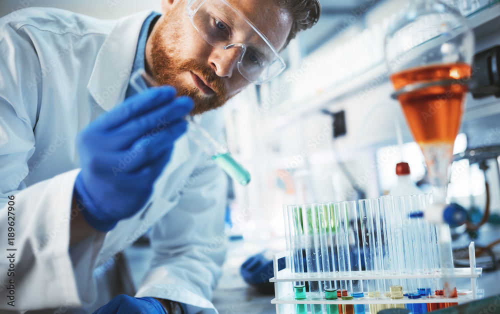 Fototapety, obrazy: Male student of chemistry working in laboratory