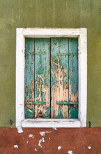 Italy, Venice, Burano Island. Old Window With Closed Old Shutters.