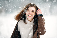 Young Woman Winter Portrait. Close-up Portrait Of Happy Girl. Expressing Positivity, True Brightful Emotions. Christmas Girl. Expressing Positivity, True Brightful Emotions