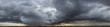Leinwandbild Motiv panorama view of cloudy gray rainy sky at sunset