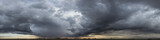 panorama view of cloudy gray rainy sky at sunset