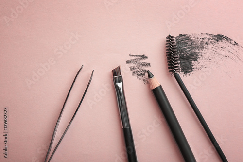 Fotografering  Tools for eyebrow dyeing and correction on color background