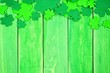Leinwanddruck Bild - St Patricks Day top border of shamrocks over a green wood background