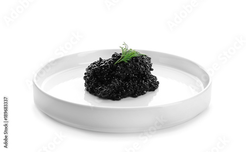 Black caviar on plate against white background