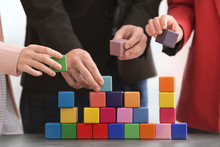 Group Of People With Colorful Cubes, Closeup. Unity Concept