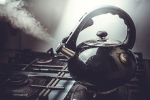 Dirty Boiling Kettle On The Stove