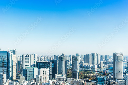Aluminium Prints Asia Business concept for real estate and corporate construction - panoramic modern city skyline bird eye aerial view near tokyo tower under bright sun and vivid blue sky in Tokyo, Japan
