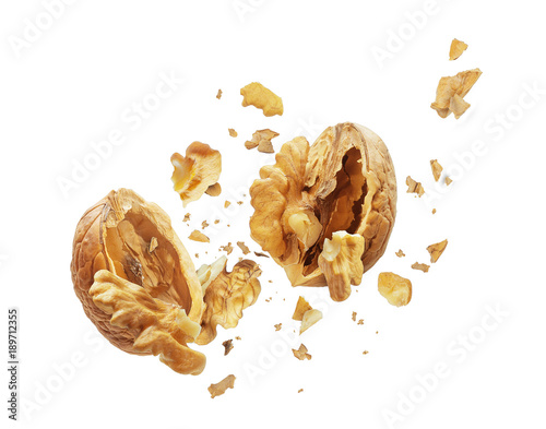 Fotografía  Walnut is torn to pieces on white background