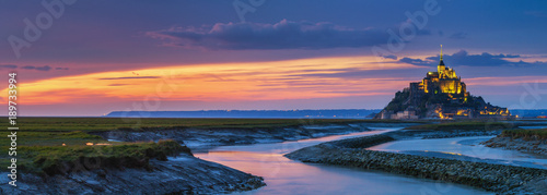 Fotografie, Obraz  Panoramic view of famous Le Mont Saint-Michel tidal island at sunset, Normandy,