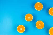 Fresh Orange Slices On Blue Background