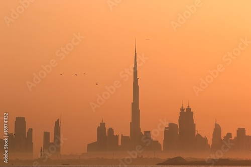 DUBAI SKYLINE UNDER SUNRISE, TWO LANDMARKS, BURJ AL ARAB AND BURJ KHALIFA, THE T фототапет