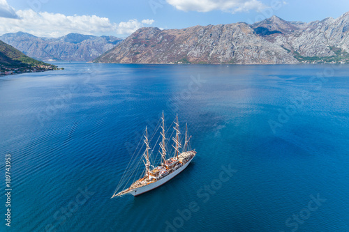 Keuken foto achterwand Schip Aerial view of the big white Sailing Ship in the Bokaktorsky Bay. Montenegro.