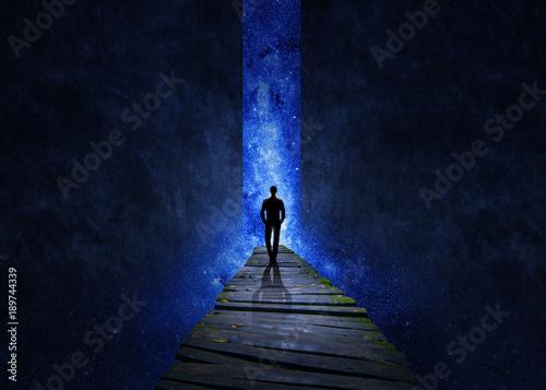 Valokuva  Man walking through the universe