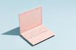 Leinwanddruck Bild - Retro pink laptop on a pastel blue background.