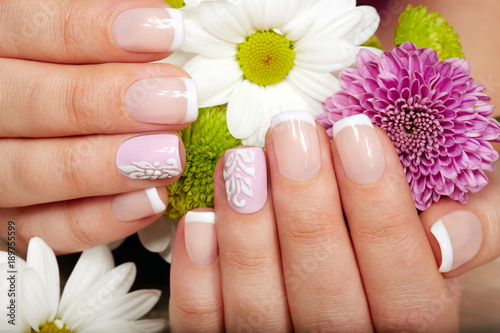Cadres-photo bureau Manicure Hands with french manicured nails and a bouquet of flowers