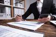 Businessperson Checking Financial Graph