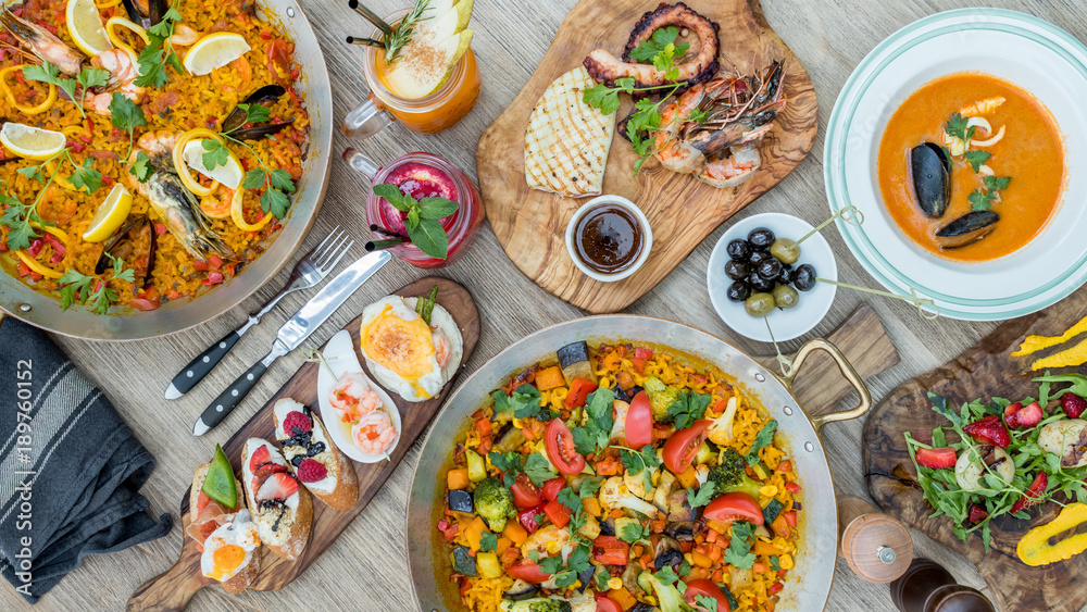 Fototapety, obrazy: Assorted spanish food set. Tapas, Paella, grilled seafood, olives, seafood soup, strawberry lemonade, grilled scallop on wooden table