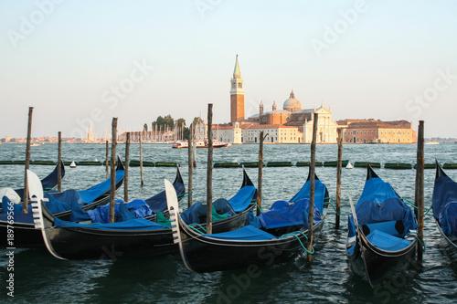 Spoed Foto op Canvas Blue gondolas in Venice on the joke.