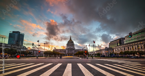 Dramatic sky over San Francisco city hall at sunset, California