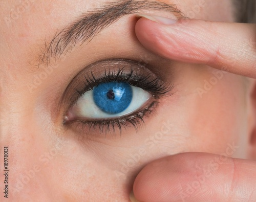 Woman stretching her eye