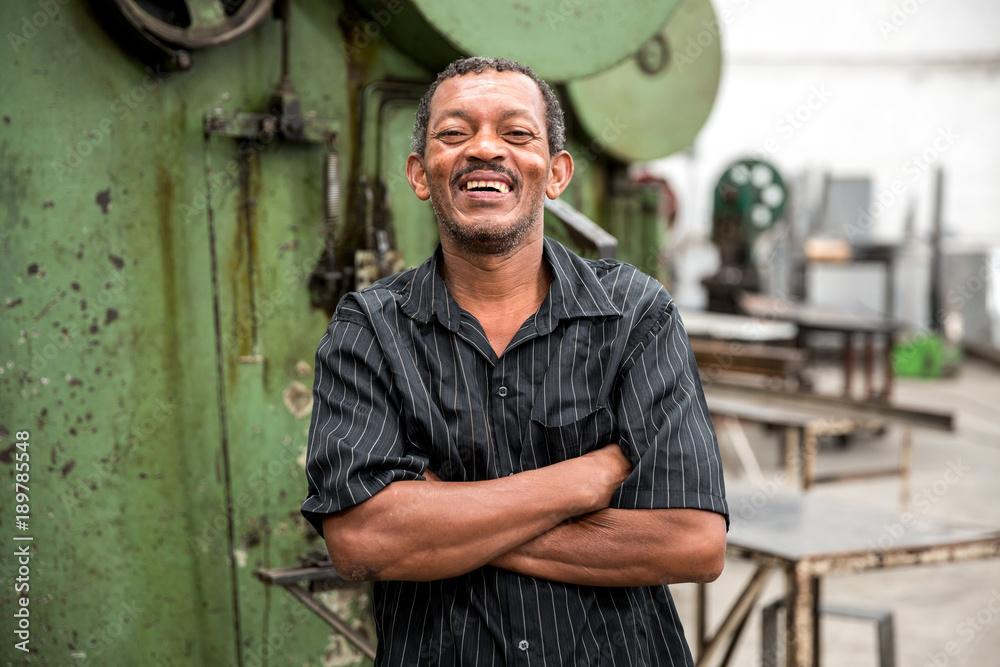 Fototapeta Portrait of Worker on Factory on background
