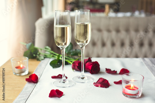 Dining table in restaurant isolated close-up champagne glasses