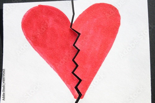 Broken Heart Symbol With Red Marker On White Paper Cut In Half With