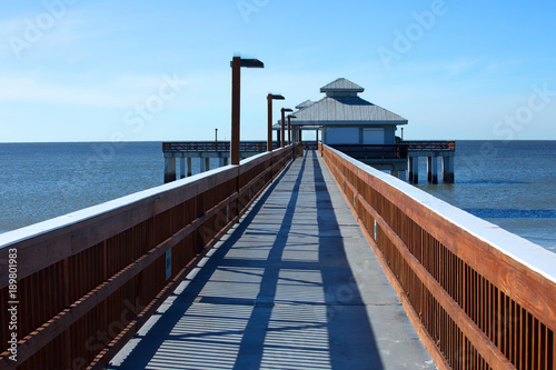 Photo  Fort Myers Beach Fishing Pier located at Times Square a popular tourist destination in Fort Myer Beach, Florida, USA