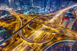 canvas print picture - Aerial view of big highway interchange with traffic in Dubai, UAE, at night. Scenic cityscape. Colorful transportation, communications and driving background.