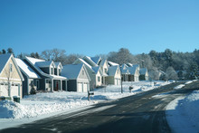 Modern Houses In A Row In Residential Area After Snow Storm