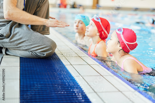 Hands Of Swim Trainer Giving Instructions To His Students Who