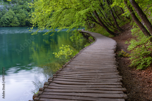 Fototapety, obrazy: Beautiful view of waterfalls with turquoise water and wooden pathway through over water. Plitvice Lakes National Park, Croatia. Famous attraction, summer landscape.