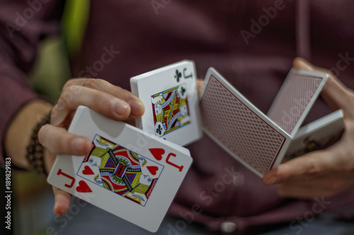 Cuadros en Lienzo Men's hands with playing cards gambling legerdemain trick