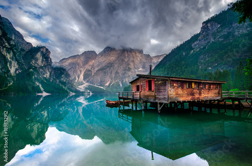 Spectacular romantic place with typical wooden boats on the alpine lake,(Lago di Fototapet
