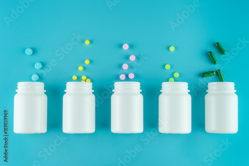 Poster Pharmacie Medicines, supplements and drugs in a bottle on blue background
