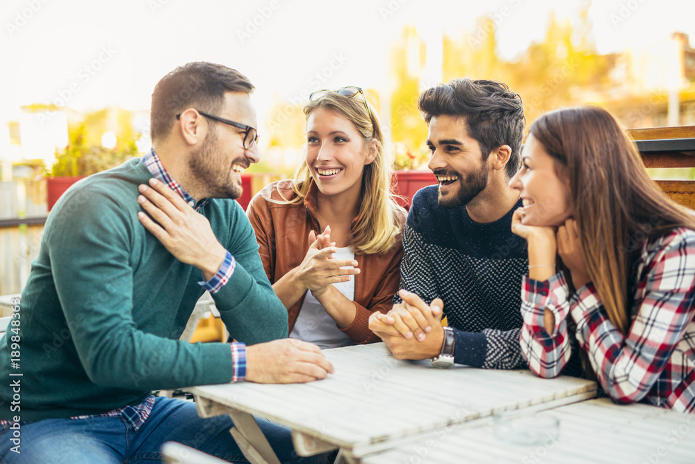Fototapety, obrazy: Group of four friends having fun a coffee together. Two women and two men at cafe talking laughing and enjoying their time