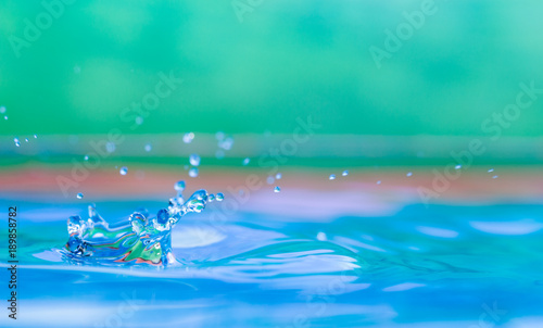 Stampa su Tela  Colorful water droplet splash photograph